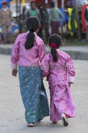 two young girls walking down a