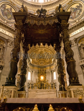 the altar with berninis baldacchino in