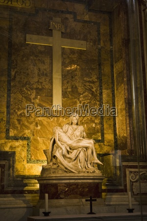 sculpture and cross in saint peters