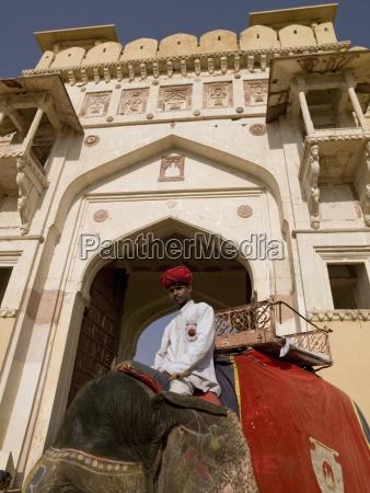 amber fortrajasthanindiaman sitting on elephant