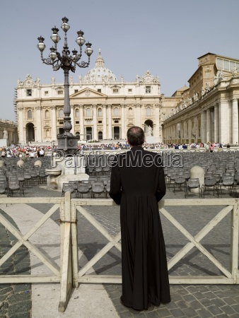 rear view of priest watching st