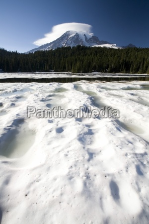 ice over reflection lake mt rainier