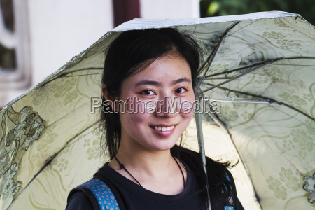 woman with umbrella suzhou jiangsu china