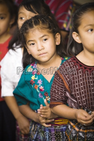 young girls in traditional clothing waiting