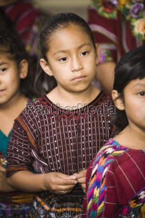 guatemalayoung girls in traditional clothing waiting