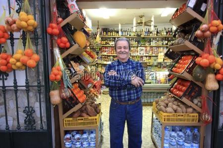 proud, shop, owner, , tarifa, , andalusia, , spain - 25418484