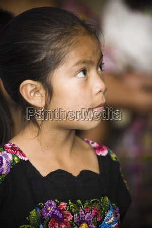 young girl in traditional clothing guatemala