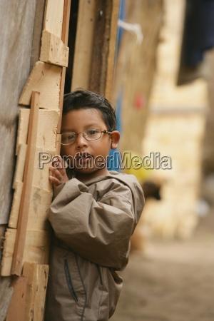 young boy wearing eyegbrille lima peru