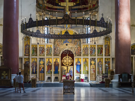 ornate interior and tourists inside st