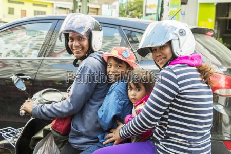 family riding a motorcycle phnom penh