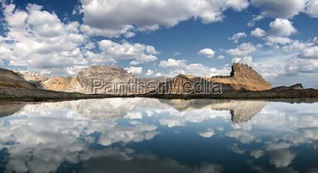 reflections in lake cirque peak banff