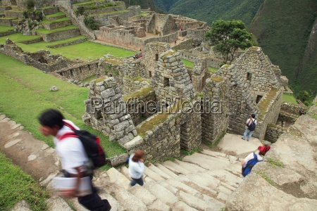 tourists on steps of machu picchu