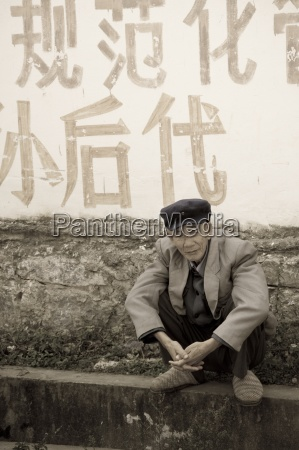 mann kauert in china