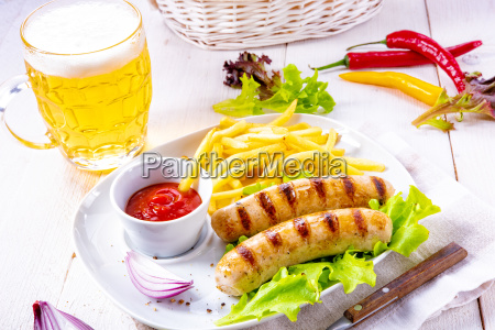grilled bratwurst with chips and cold