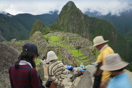 tourist group descending steps machu picchu