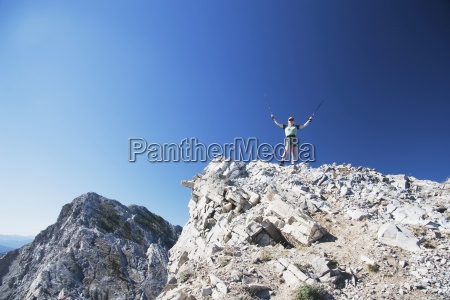 female hiker at the top of