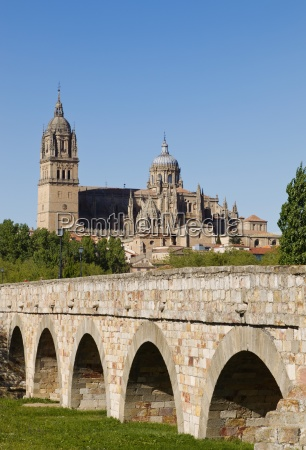 cathedral seen beyond roman bridge over
