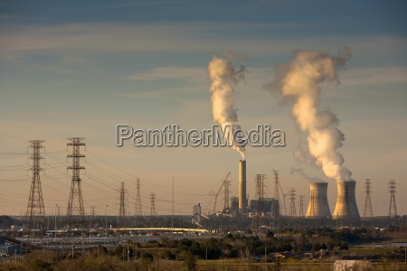 smoke stacks and power transmission lines