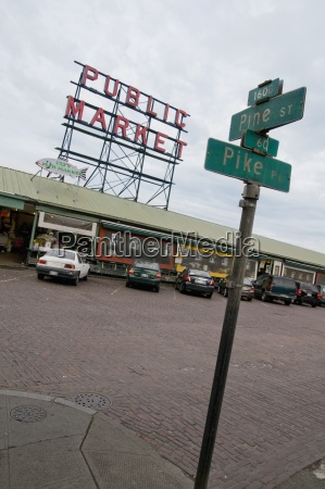 street signs and cars parked at