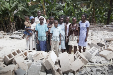 a haitian family stands among the