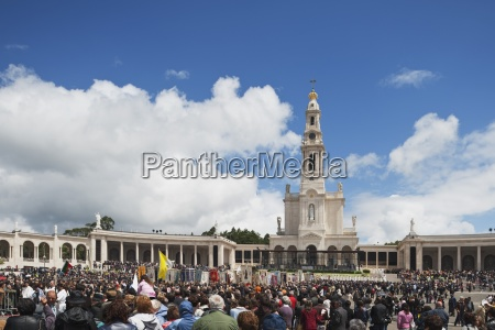 a crowd at the basilica of