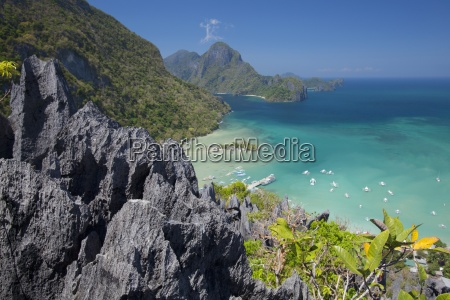 tropical island with boats in the