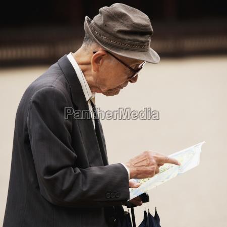 a man reading a map tokyo
