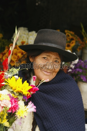 senior woman in flower shop lima