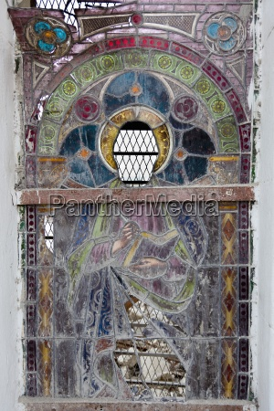 an ornate stained glass window in