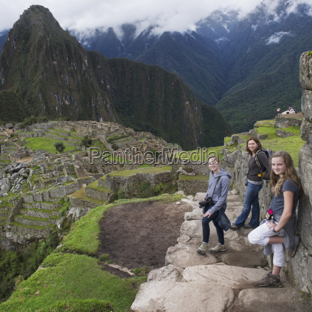 a mother and daughters at machu