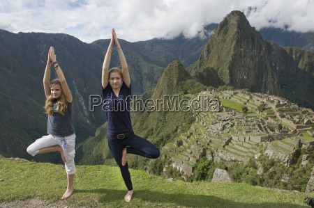 two girls doing a pirouette on