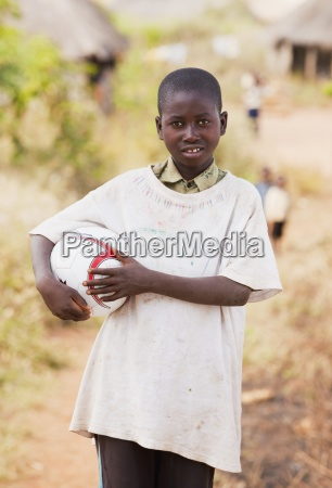 a young man holding a football