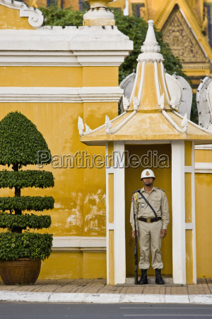 a guard stands outside the royal