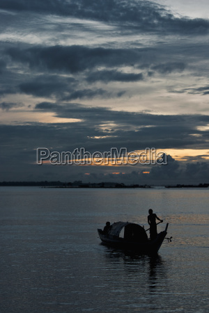 boatsmen on the mekong river at