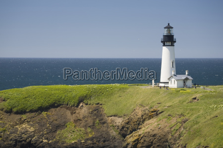 white lighthouse on the ocean with