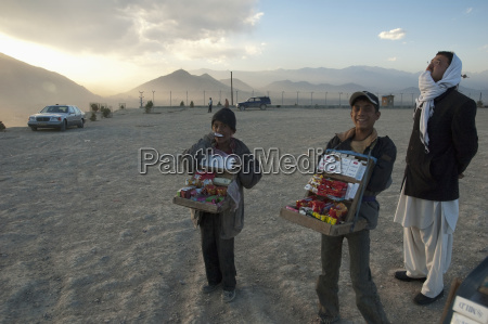 afghan boys selling cigarettes and candy