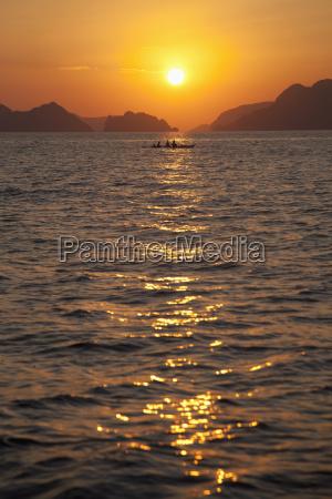 sunset over the mountainous coast corong
