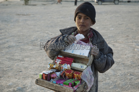 afghan boy selling cigarettes and candy