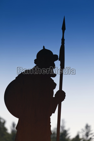 silhouette of cut out figure depicting