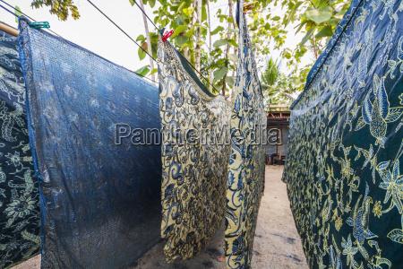 batik cloths drying in the sun