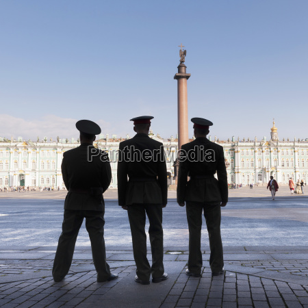 silhouette of three officers standing with