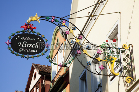 a decorative colourful sign hanging from