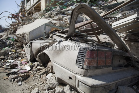 a building collapsed on a vehicle