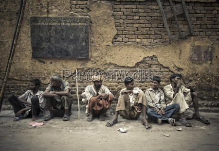 a group of male laborers sitting