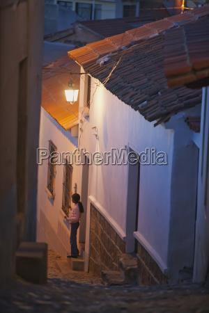 girl standing at doorsteps sucre chuquisaca