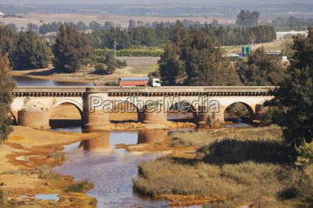 the roman bridge crossing the rio