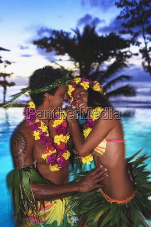 tahitian couple in traditional tamure dance