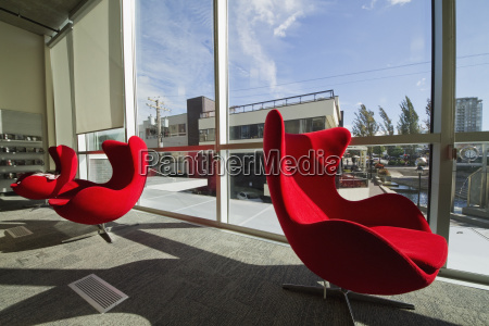 contemporary red chairs in the city