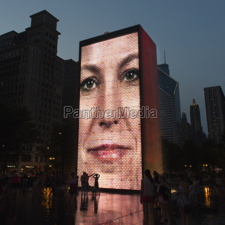 image of a womans face projected
