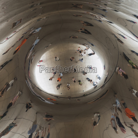 reflection of people in a silver